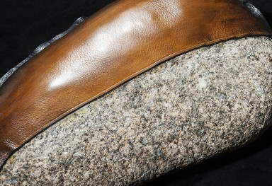 Stones covered with patina barenia leather